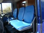 Cab shot of an Iveco build showing the re-upholstery of the cab seating to match the living colour scheme. All colours are chosen by the client with a wide range of colours available.